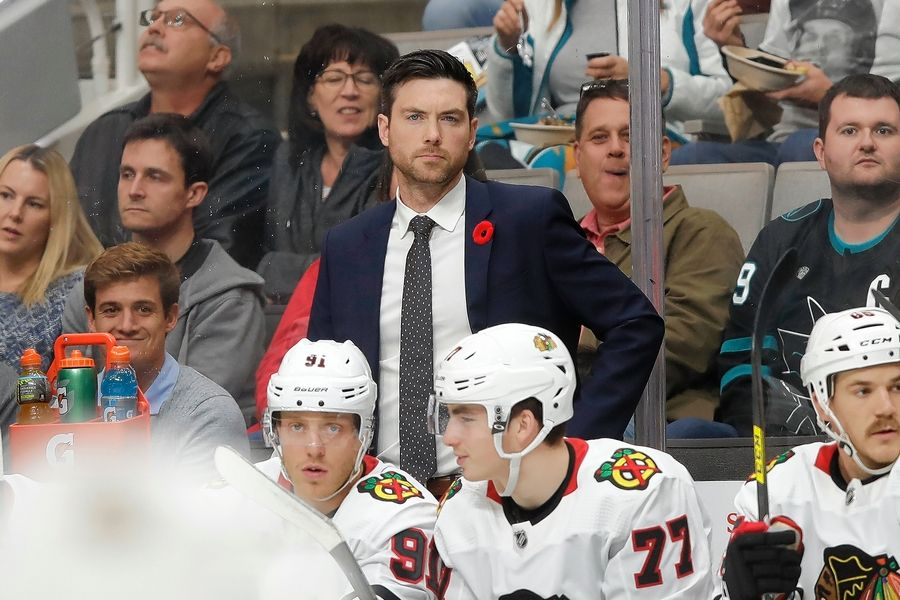 Chicago Blackhawks head coach Jeremy Colliton, center, watches against the San Jose Sharks during an NHL hockey game in San Jose, Calif., Tuesday, Nov. 5, 2019.