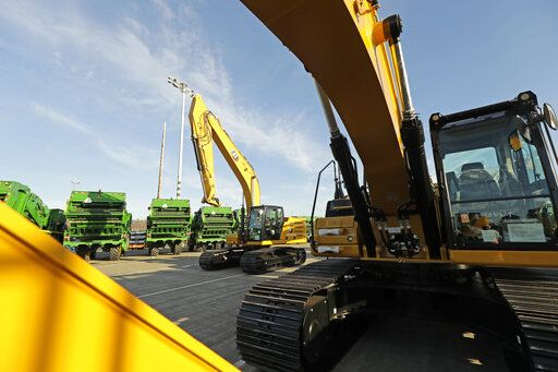 FILE - In this Nov. 4, 2019, file photo construction equipment made by Caterpillar are readied for export to Asia at the Port of Tacoma in Tacoma, Wash. Caterpillar Inc. reports financial results Friday, Jan. 31, 2020.