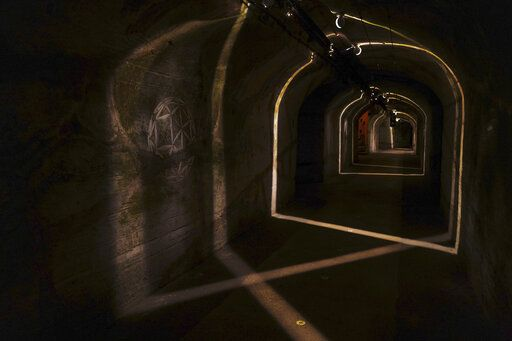 An art creation exhibited in the cave of the Vranken-Pommery Monopole in Reims, the Champagne region, east of Paris, Tuesday, July 28, 2020. Producers in France's eastern Champagne region, headquarters of the global industry, say they've lost about 1.7 billion euros ($2 billion) in sales this year, as turnover fell by a third -  a hammering unmatched in living memory, and worse than the Great Depression.