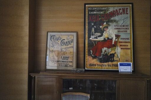 Old posters of champagne advertising displayed in the room of the Champagne Committee, an organization that represents some 16,000 winemakers and 300 Champagne houses during an interview in Epernay, the Champagne region, east of Paris, Tuesday, July 28, 2020. Producers in France's eastern Champagne region, headquarters of the global industry, say they've lost about 1.7 billion euros ($2 billion) in sales this year, as turnover fell by a third -  a hammering unmatched in living memory, and worse than the Great Depression.