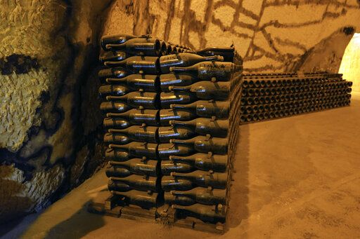 Champagne bottles piled in the cave of the Vranken-Pommery Monopole in Reims, the Champagne region, east of Paris, Tuesday, July 28, 2020. Producers in France's eastern Champagne region, headquarters of the global industry, say they've lost about 1.7 billion euros ($2 billion) in sales this year, as turnover fell by a third -  a hammering unmatched in living memory, and worse than the Great Depression.