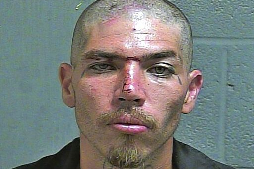 In this June 21, 2019 photo provided by the Oklahoma County Detention Center is inmate Pablo Robledo. Authorities are seeking Robledo, a murder suspect who escaped the Oklahoma County jail in Oklahoma City early Friday, July 31, 2020. Robledo, who was being held on a first-degree murder charge and his cellmate escaped by breaking a window of their 12th floor cell and using sheets tied together to climb down the outside of the building, according to jail spokesman Mac Mullings. (Oklahoma County Detention Center via AP)