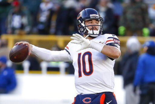FILE - In this Dec. 15, 2019, file photo, Chicago Bears' Mitchell Trubisky warms up before an NFL football game against the Green Bay Packers, in Green Bay, Wis. Trubisky understands why the Bears acquired quarterback Nick Foles. That doesn't mean he's ready to hand over the starting job. Trubisky said the trade for Foles gave him extra motivation to show he can develop into the franchise quarterback the Bears thought he would become when they moved up a spot to draft him with the No. 2 overall pick in 2017.  'œThat's the business we're in,'� he said in a conference call on Friday, June 12, 2020.