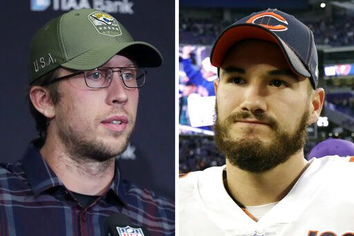 FILE - From left are 2019 file photos showing then-Jacksonville Jaguars quarterback Nick Foles speaking in Indianapolis and Chicago Bears quarterback Mitchell Trubisky speaking n Minneapolis. Trubisky understands why the Bears acquired quarterback Nick Foles. That doesn't mean he's ready to hand over the starting job. Trubisky said the trade for Foles gave him extra motivation to show he can develop into the franchise quarterback the Bears thought he would become when they moved up a spot to draft him with the No. 2 overall pick in 2017.