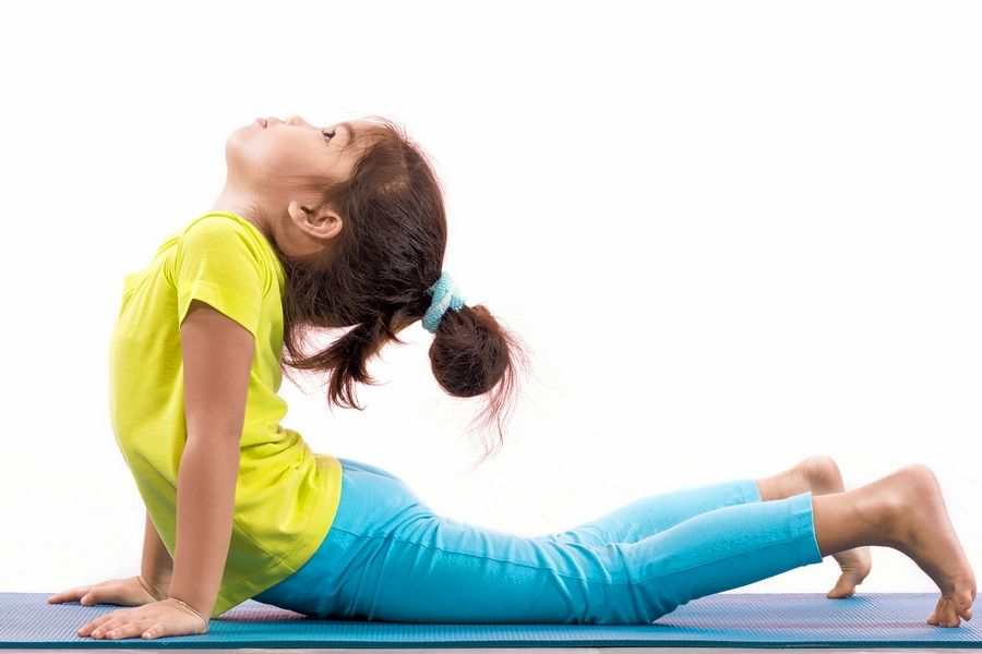 Stock PhotoThe key to yoga for kids is for it to be fun, a tiny bit challenging and stress-free.