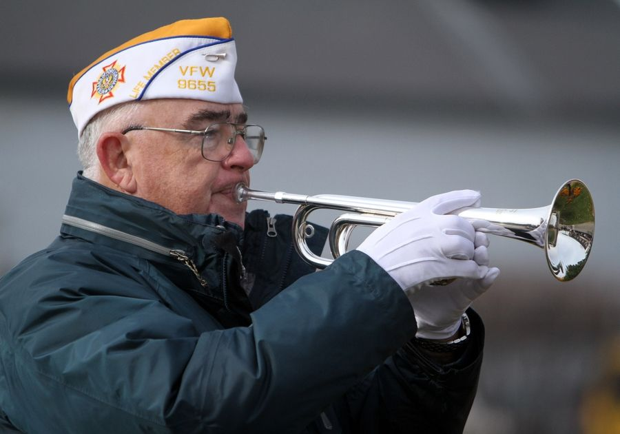 "Jim Reynolds of Round Lake Park has played taps at more than 1,000 events since joining the organization Bugles Across America, many of them funerals for fellow veterans. ""We feel the veteran has paid the price or earned the honors and we are there to make sure our nation's debt is paid,"" he said."