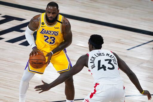 Toronto Raptors' Pascal Siakam (43) guards Los Angeles Lakers' LeBron James (23) during the first half of an NBA basketball game Saturday, Aug. 1, 2020, in Lake Buena Vista, Fla.