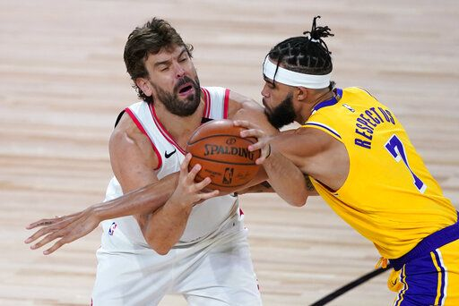 Los Angeles Lakers' JaVale McGee (7) guards Toronto Raptors' Marc Gasol during the second half of an NBA basketball game Saturday, Aug. 1, 2020, in Lake Buena Vista, Fla.