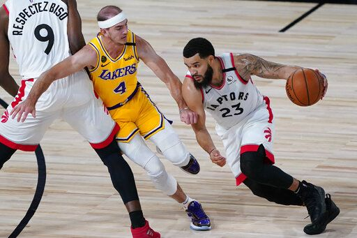 Toronto Raptors' Fred VanVleet (23) drives into Los Angeles Lakers' Alex Caruso (4) during the first half of an NBA basketball game Saturday, Aug. 1, 2020, in Lake Buena Vista, Fla.