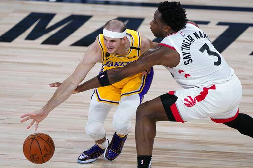 Toronto Raptors' OG Anunoby (3) tries to steal the ball from Los Angeles Lakers' Alex Caruso during the first half of an NBA basketball game Saturday, Aug. 1, 2020, in Lake Buena Vista, Fla.