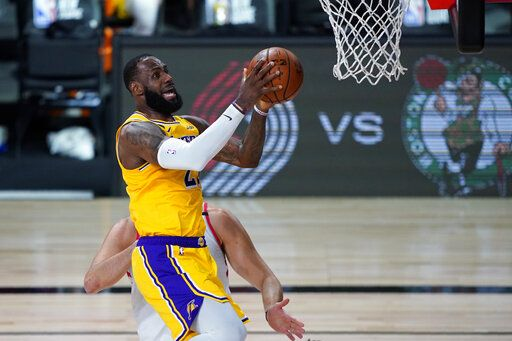 Los Angeles Lakers' LeBron James shoots against the Toronto Raptors during the first half of an NBA basketball game Saturday, Aug. 1, 2020, in Lake Buena Vista, Fla.