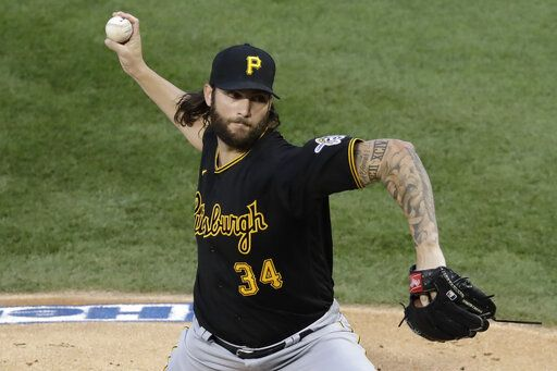 Pittsburgh Pirates starting pitcher Trevor Williams throws against the Chicago Cubs during the first inning of a baseball game in Chicago, Friday, July 31, 2020.