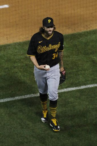 Pittsburgh Pirates starting pitcher Trevor Williams holds the baseball as he walks to the dugout after the fourth inning of a game against the Chicago Cubs in Chicago, Friday, July 31, 2020.