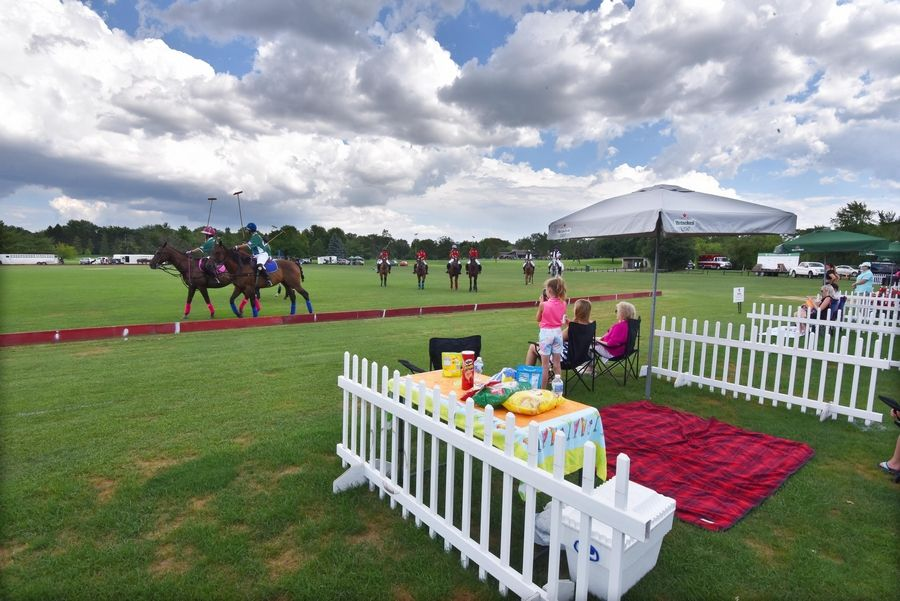 Spectators are asked to stay in an assigned fenced area at the Oak Brook Polo Club. Tailgating has replaced grandstands to follow social distancing orders.
