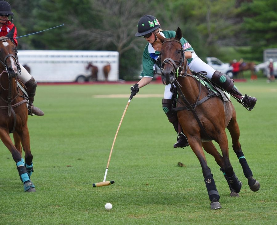 Grace Mudra, 17, hits toward the goal in the U.S. Polo Association Women's Challenge Final at the Oak Brook Polo Club Sunday. She is from Naperville.