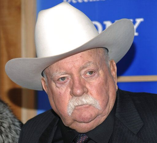 FILE - In this Monday, Dec. 14, 2009 file photo, Actor Wilford Brimley attends the premiere of 'Did You Hear About The Morgans' at the Ziegfeld Theater in New York. Wilford Brimley, who worked his way up from stunt performer to star of film such as 'œCocoon'� and 'œThe Natural,'� has died. He was 85. Brimley's manager Lynda Bensky said the actor died Saturday morning, Aug. 1, 2020 in a Utah hospital.