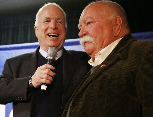 FILE - In this Jan. 4, 2008, file photo, Republican presidential hopeful, Sen. John McCain, R-Ariz., left, introduces actor, Wilford Brimley, after making a reference to fellow Republican presidential hopeful, former Arkansas Gov. Mike Huckabee, campaigning with actor Chuck Norris, as McCain makes a campaign stop at Hudson Veterans of Foreign Wars Post 5791, in Hudson, N.H. Brimley, who worked his way up from stunt performer to star of film such as 'œCocoon'� and 'œThe Natural,'� has died. He was 85. Brimley's manager Lynda Bensky said the actor died Saturday morning, Aug. 1, 2020 in a Utah hospital.