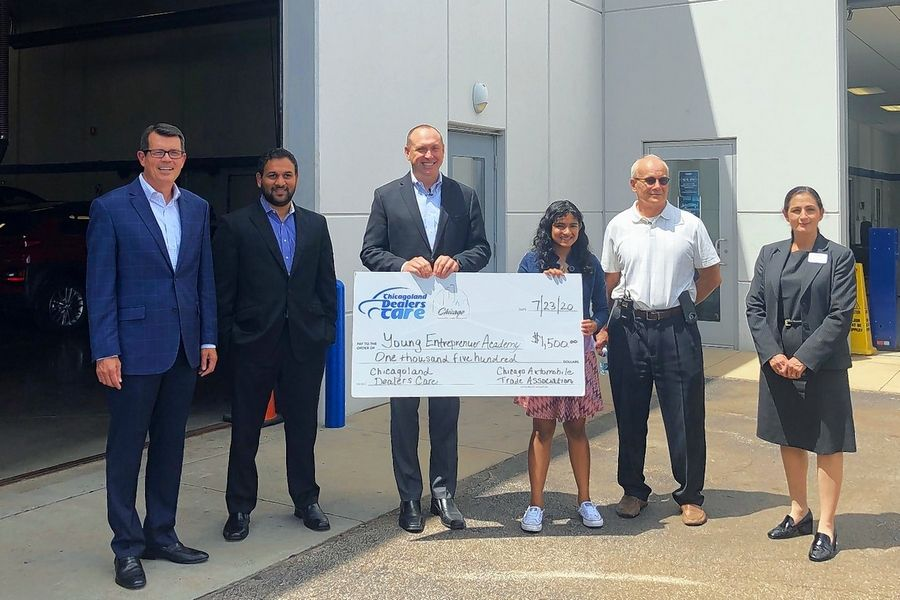 The Chicago Automobile Trade Association recently made a $1,500 donation to the Young Entrepreneurs Academy in Palatine. Presenting the check were, from left. David Sloan, Chicago Automobile Trade Association president; Ahmad Ali, regional manager, Leader Auto; Kevin Keefe, Chicago Automobile Trade Association chairman; Rhea Makkuni, Young Entrepreneur's Academy student alumni; Steven Gaus, Palatine Chamber of Commerce executive director; and Tamara Darvish, district manager, Leader Automotive.