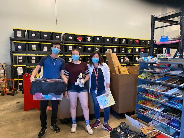 Left to right: GiveNKind volunteers Filippo, Martina and Lavinia LoBue are pictured as they unpacked donations at the organization's Buffalo Grove warehouse in early June.GiveNKind