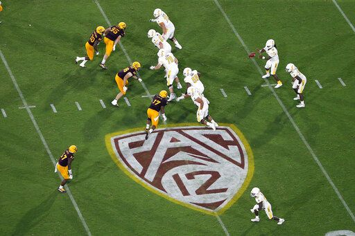 FILE - This Thursday, Aug. 29, 2019, file photo, shows the Pac-12 logo during the second half of an NCAA college football game between Arizona State and Kent State, in Tempe, Ariz. The Pac-12 has set Sept. 26 as the start of its 10-game conference-only football schedule. The Pac-12 announced three weeks ago it would eliminate nonconference games for its 12 member schools.