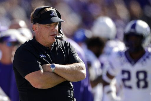 FILE - In this Oct. 19, 2019, file photo, TCU coach Gary Patterson watches during the first half of the team's NCAA college football game against Kansas State in Manhattan, Kan. TCU's chancellor said coach Gary Patterson apologized Monday, Aug. 3, 2020 for repeating a racial slur when telling a player to stop using the slur in team meetings. Linebacker Dylan Jordan accused Patterson on Twitter of using the slur during a confrontation at practice