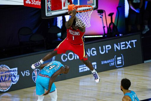 New Orleans Pelicans' Zion Williamson (1) comes down after a dunk over Memphis Grizzlies' Anthony Tolliver (44) during the first half of an NBA basketball game Monday, Aug. 3, 2020 in Lake Buena Vista, Fla.