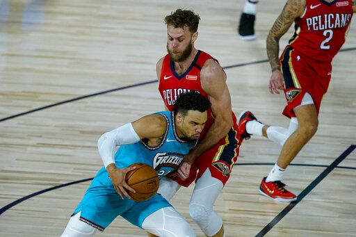 Memphis Grizzlies' Dillon Brooks (24) tries to get past New Orleans Pelicans' Nicolo Melli (20) during the first half of an NBA basketball game Monday, Aug. 3, 2020 in Lake Buena Vista, Fla.