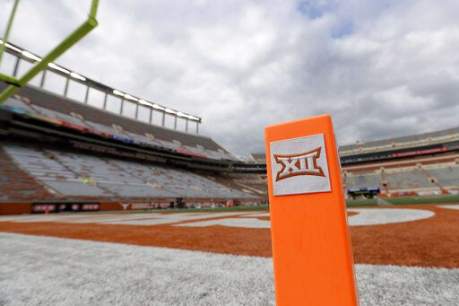 FILE - In this Oct. 7, 2017, file photo, a Big 12 pylon marks the end zone at Darrell K Royal Texas Memorial Stadium before an NCAA college football game between Texas and Kansas State in Austin, Texas. Big 12 schools have agreed to play one nonconference football game this year to go along with their nine league contests as plans for the pandemic-altered season continued to fall into place.