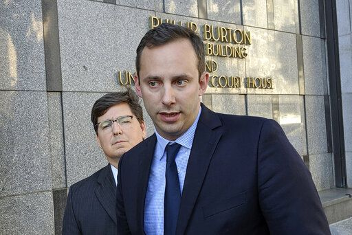 FILE - In this Sept. 24, 2019, file photo, former Google engineer Anthony Levandowski speaks to the media, as his attorney Miles Ehrlich stands behind him outside of a federal courthouse in San Francisco. Levandowski, a former Google engineer who helped steer the company's self-driving car project, was sentenced Tuesday, Aug. 4, 2020, to 18 months in prison and ordered to pay more than $850,000 after pleading guilty to stealing trade secrets before joining Uber's effort to build robotic vehicles for its ride-hailing service.