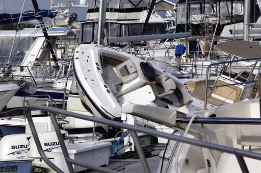 Boats are piled on each other at the Southport Marina following the effects of Hurricane Isaias in Southport, N.C., Tuesday, Aug. 4, 2020.