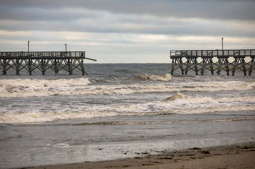 The private Sea Cabins pier is seen damaged following Hurricane Isaias, in North Myrtle Beach, S.C., Tuesday, Aug. 4, 2020. (Jason Lee/The Sun News via AP)