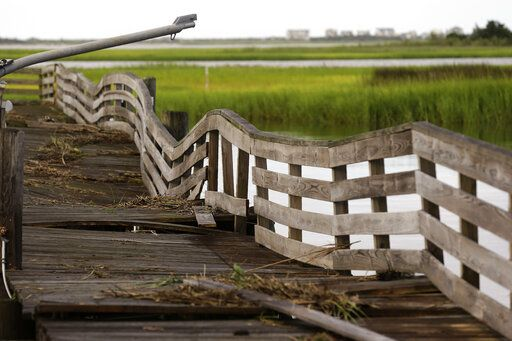 A pier shows damages following the effects of Hurricane Isaias in Southport, N.C., Tuesday, Aug. 4, 2020.