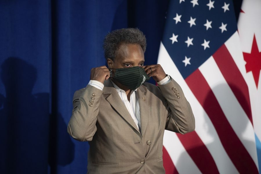 Chicago Mayor Lori Lightfoot wears her mask Wednesday after speaking about Chicago Public Schools' plans for remote learning in the fall.