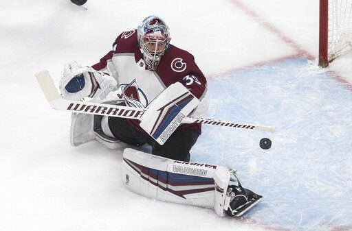 Colorado Avalanche goalie Pavel Francouz (39) makes the save against the Dallas Stars during first period NHL qualifying round game action in Edmonton, on Wednesday, Aug. 5, 2020. (Jason Franson/The Canadian Press via AP)