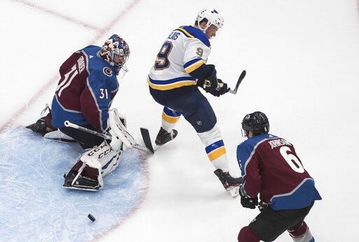 Colorado Avalanche goalie Philipp Grubauer (31) makes a save as St. Louis Blues' Sammy Blais (9) tries to screen the shot during the third period of an NHL hockey playoff game Sunday, Aug. 2, 2020, in Edmonton, Alberta. (Jason Franson/The Canadian Press via AP)