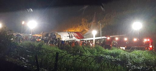 The Air India Express flight that skidded off a runway while landing at the airport in Kozhikode, Kerala state, India, Friday, Aug. 7, 2020.