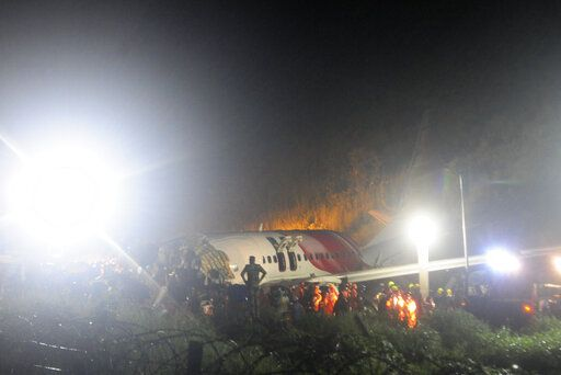 The Air India Express flight that skidded off a runway while landing at the airport in Kozhikode, Kerala state, India, Friday, Aug. 7, 2020. The special evacuation flight bringing people home to India who had been trapped abroad because of the coronavirus skidded off the runway and split in two while landing in heavy rain killing more than a dozen people and injuring dozens more.