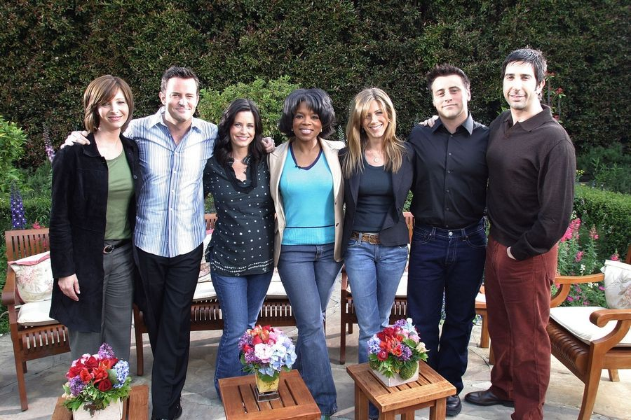 "Talk-show host Oprah Winfrey, center, poses with the cast of ""Friends"" in 2004. Cast members from left are: Lisa Kudrow, Matthew Perry, Courteney Cox Arquette, Jennifer Aniston, Matt LeBlanc and David Schwimmer."
