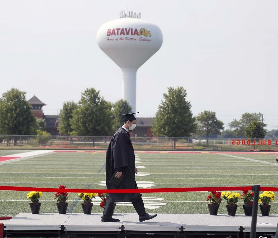 Zachary Aziz-Antal walks across the stage during the Batavia High School graduation ceremony on the football field Saturday.