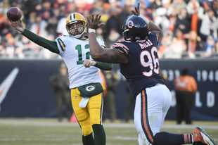 Chicago Bears defensive end Akiem Hicks, seen here pressuring Green Bay Packers quarterback Aaron Rodgers during a 2018 game, was a big part of the Bears' defense for the first four games last season. When Hicks went down with an elbow injury, the defense seemed to lose its luster.