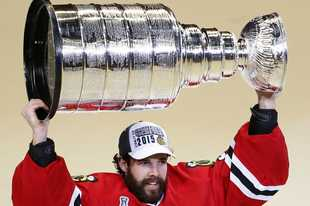 Blackhawks goalie Corey Crawford hoists the Stanley Cup trophy after defeating the Tampa Bay Lightning in June 2015.