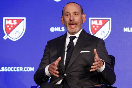 FILE - In this Feb. 26, 2020, file photo, Major League Soccer Commissioner Don Garber speaks during the Major League Soccer 25th Season kickoff event in New York. Major League Soccer said Saturday, Aug. 8, 2020, it will resume its season once the MLS is Back tournament in Florida wraps up.  The league's 26 teams will each play 18 games, with the first between FC Dallas and Nashville set for Aug. 12.
