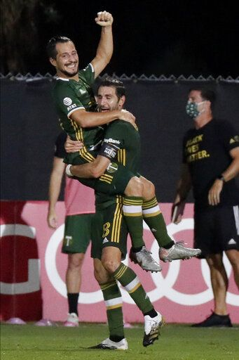 Portland Timbers midfielder Sebastian Blanco, top, celebrates his goal with Diego Valeri against the Philadelphia Union during the second half of an MLS soccer match, Wednesday, Aug. 5, 2020, in Kissimmee, Fla.