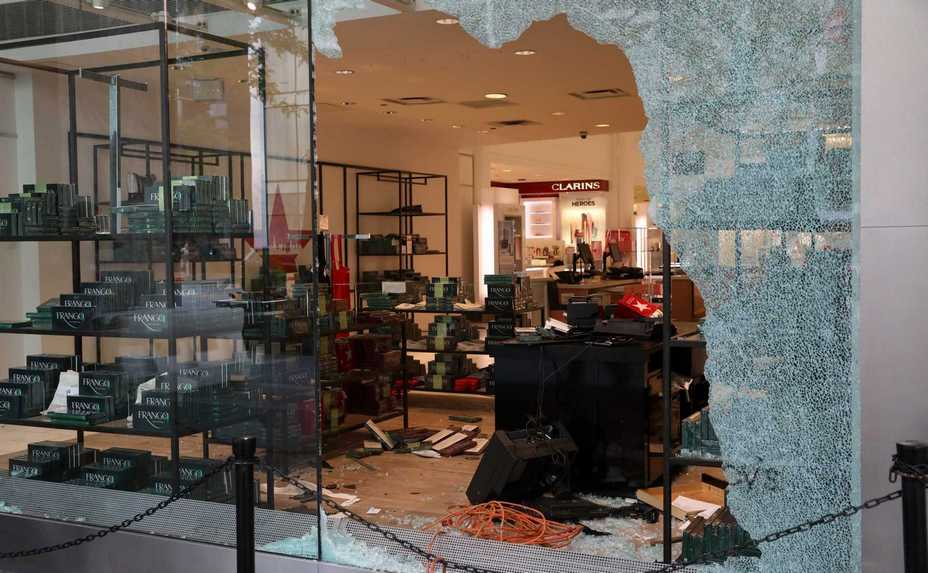 A window was smashed at the Michigan Avenue Macy's store at Water Tower Place in Chicago. More than 100 people were arrested Monday following a night of looting and unrest that left 13 officers injured and caused damage in the city's upscale Magnificent Mile shopping district and other parts of the city.