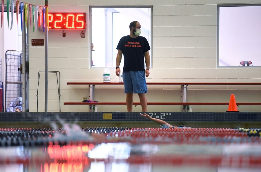 Head coach Alex Mikolajewski oversees Barrington High School's first day of girls swimming and diving practice Monday.