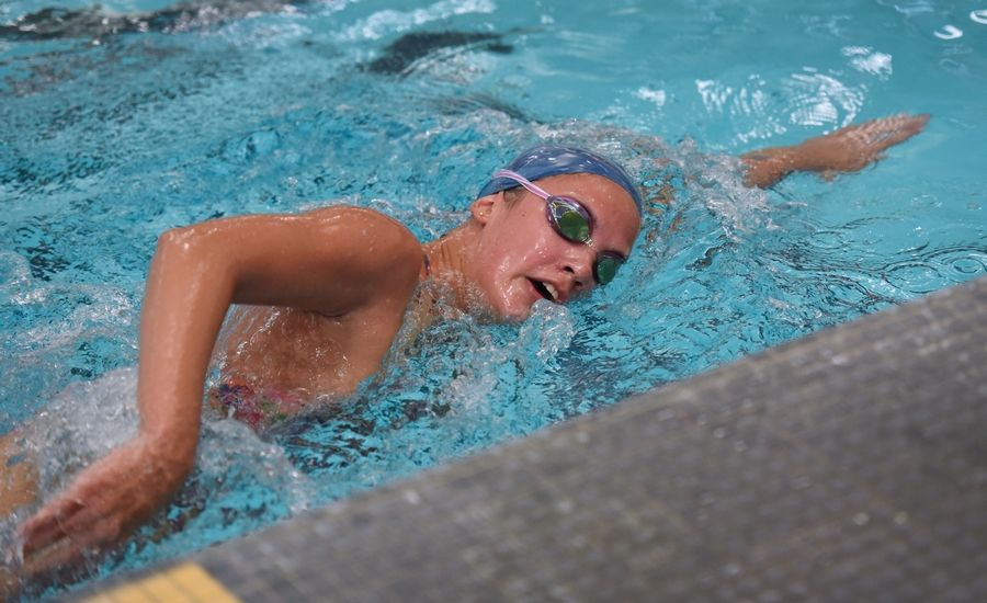 Barrington's Alyssa Schwengel swims laps during Monday's first day of practice.