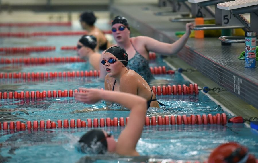Barrington swimmers adhered to social distancing Monday during first day of practice for the fall season.