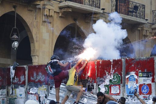 Anti-government protesters use fireworks against Lebanese riot police during a protest in the aftermath of last Tuesday's massive explosion which devastated Beirut, Lebanon, Monday, Aug. 10, 2020.