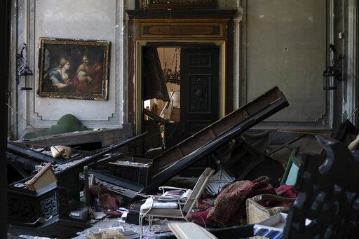 A painting hangs on the wall of a heavily damaged room in the Sursock Palace after the explosion in the seaport of Beirut, Lebanon, Saturday, Aug. 8, 2020. The level of destruction from the massive explosion at Beirut's port last week is ten times worse than what 15 years of civil war did.