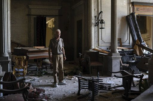 "Roderick Sursock stands in a heavily damaged room of the Sursock Palace, affected by the explosion in the seaport of Beirut, Lebanon, Saturday, Aug. 8, 2020. ""In a split second, everything was destroyed again,"" said Sursock, owner of the charming Sursock Palace, one of the most prominent and well-known buildings in the Lebanese capital."